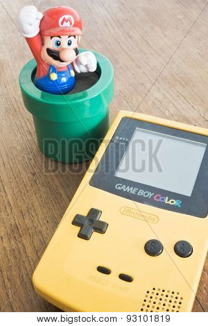 Game Boy Color Device With Super Mario Bros Figure