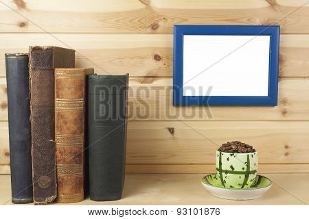 wooden shelf with old book and picture frame for your text.