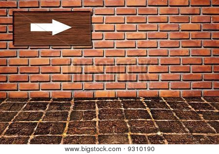 Arrow Sign On Brickwall Pattern