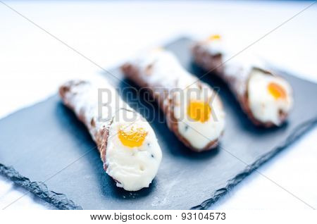 Typical sweet Italian consist cannoli baba and pastries