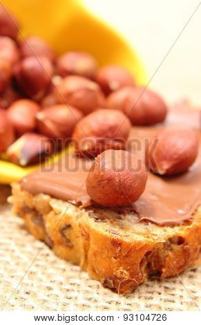 Hazelnut And Slices Of Bread With Chocolate Cream