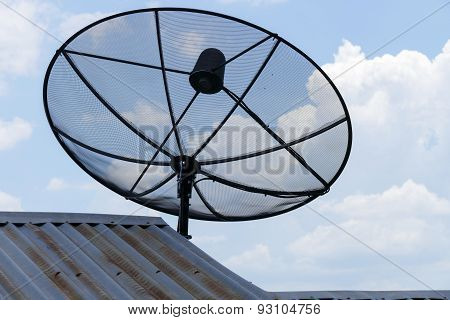 Satellite Dish On The Galvanized Roof