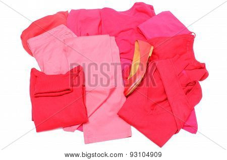 Heap Of Red And Pink Clothes With Womanly Shoes