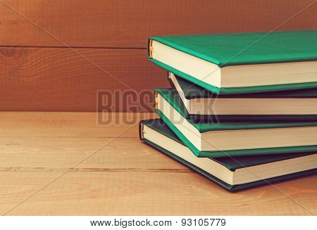 Stack of books on a wooden background