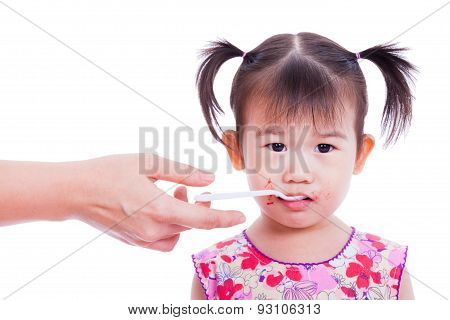 Little Asian (thai) Girl Holding Spoon In Mouth