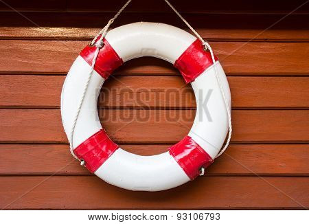 Lifebuoy Hanging On Wood Wall