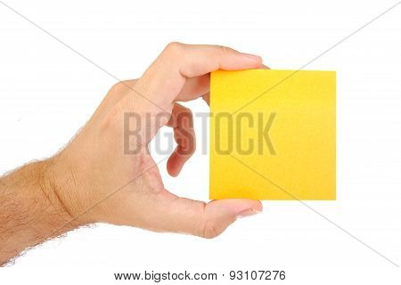 Man hand holding sticky note isolated on a white background