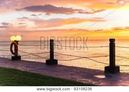 Walking Path By The Sea With Beautiful Sunset
