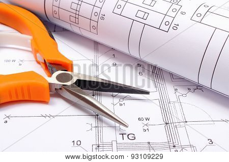Metal Pliers And Rolled Electrical Diagram On Construction Drawing Of House