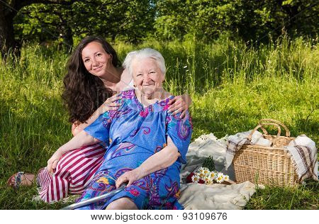 Smiling Grandmother With Granddaughter
