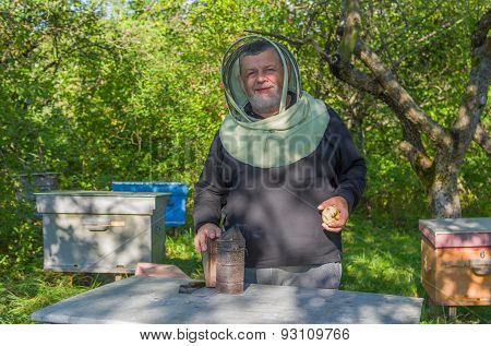 Portrain of Ukrainian smiling senior bee-keeper