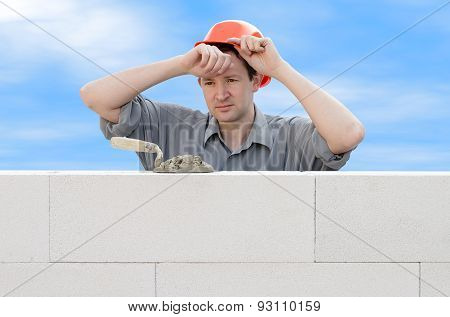 Construction Worker Wiping The Sweat From His Forehead