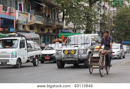 People, Cars And Bikes On The Streets In Mandalay