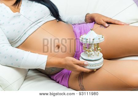 Pregnant woman showing belly to camera