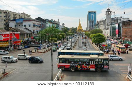Traffic, People, And Buildings In Downtown Yangon