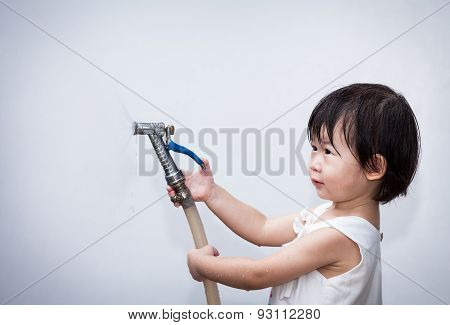 Little Asian Girl Play With Water Hose