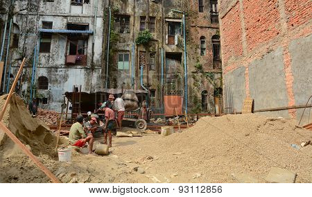 Asian Workers Working At The Construction Site