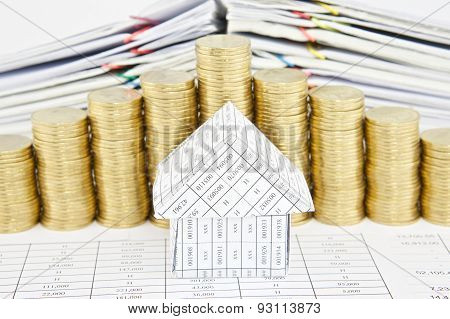 Close Up House With Step Pile Of Gold Coins