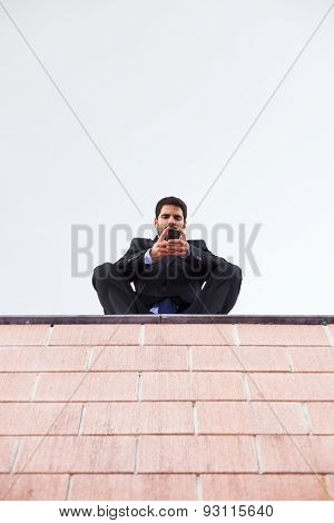 Businessman using his smart phone