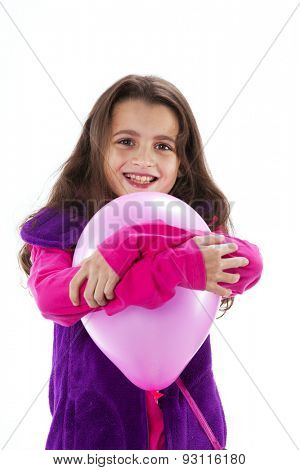 Little girl holding a balloon