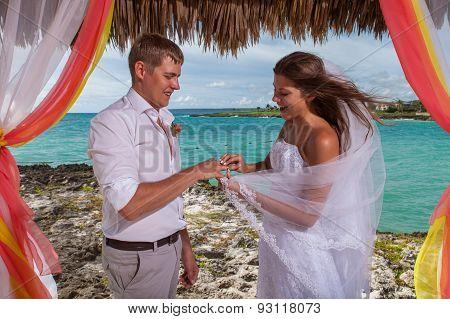 Young Loving Couple Wedding In Gazebo