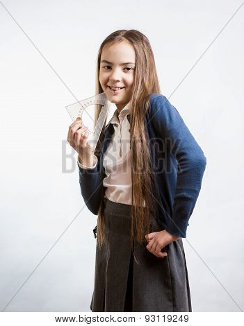 Schoolgirl Holding Triangle Protractor Against White Background