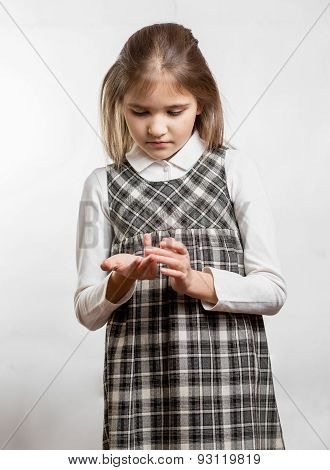 Cute Little Girl Counting Fingers Against White Background