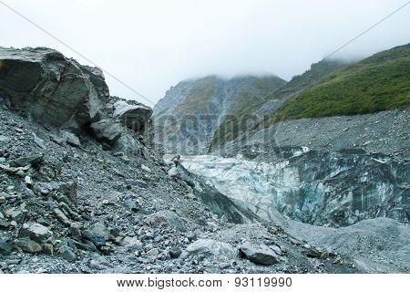 Blue Ice And Gray Rocks Of Fox Glacier, New Zealand