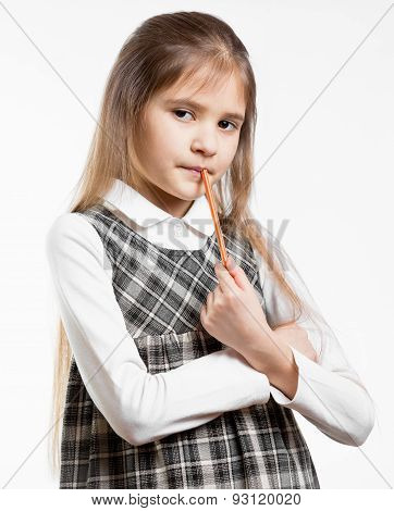 Cute Schoolgirl Posing With Pencil Against White Background