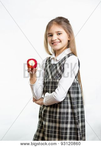Isolated Portrait Of Happy Girl In School Uniform Holding Apple
