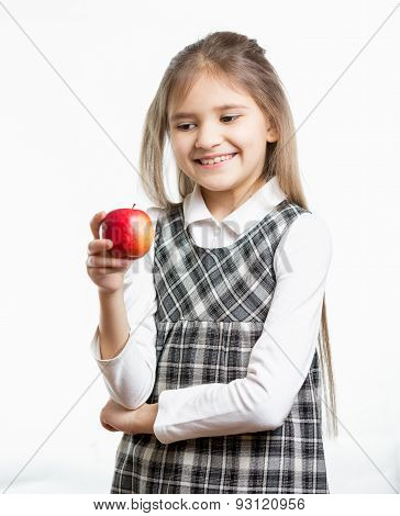 Isolated Portrait Of Smiling Schoolgirl Looking At Apple