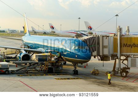 KUALA LUMPUR, MALAYSIA - MAY 06, 2014: docked jet aircraft. Kuala Lumpur International Airport (KLIA) is Malaysia's main international airport and one of the major airports of South East Asian