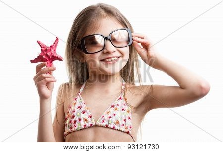 Portrait Of Smiling Brunette Girl Posing With Red Starfish