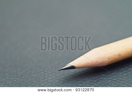 Sharp pencil on dark background