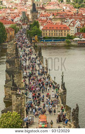 Tourists At Prague Charles Bridge