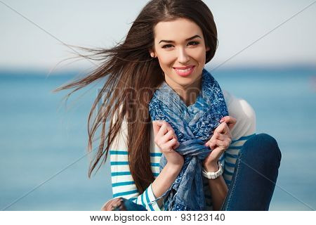 Fashionable young woman on the beach in the fall