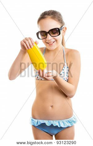 Isolated Portrait Of Smiling Girl Pouring Suntan Lotion On Hand