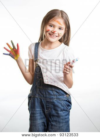 Smiling Girl With Painted Hands And Face Over White Background