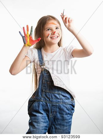 Cute Smiling Girl With Painted Face And Hands Drawing In The Air