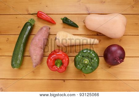 Selection Of Raw Vegetables On A Wooden Table