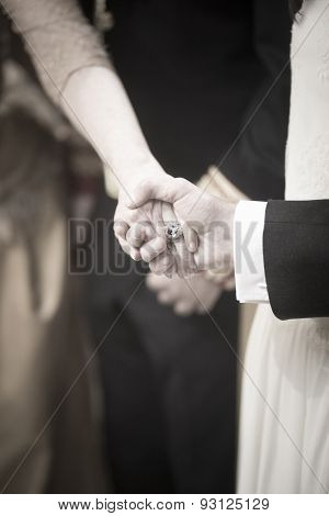Bride And Bridegroom In Wedding Marriage Ceremony Holding Hands