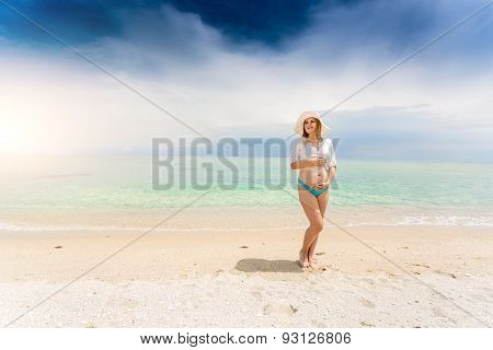 Pregnant Woman Posing Seashore And Holding Hands On Abdomen