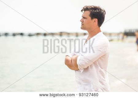 Portrait Of Handsome Young Man Looking On The Horizon At Ocean