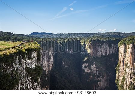CAMBARA DO SUL, BRAZIL - JUNE 07: Tourists watch a Canyon at a viewpoint on June 07, 2015