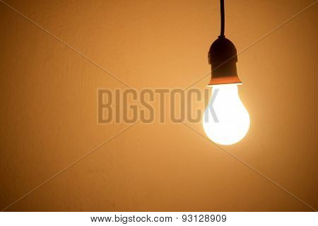 Lightbulb Lamp orange light in room at night