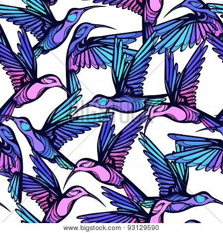 Flying tropical stylized colorful hummingbirds seamless pattern.