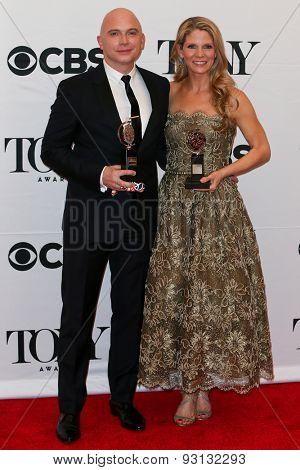 NEW YORK-JUN 7: Actors Michael Cerveris (L) and Kelli O'Hara hold the trophy at the American Theatre Wing's 69th Annual Tony Awards at Radio City Music Hall on June 7, 2015 in New York City.