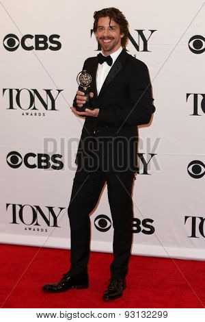 NEW YORK-JUN 7: Actor Christian Borle holds the trophy at the American Theatre Wing's 69th Annual Tony Awards at Radio City Music Hall on June 7, 2015 in New York City.