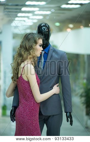 Attractive Girl And Mannequin