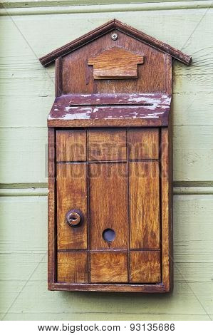 Old wooden mail box on the wall